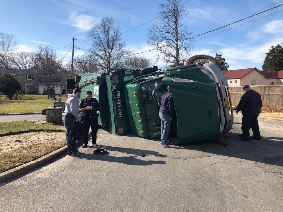 Overturned Garbage Truck